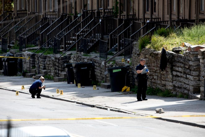 Cincinnati Police investigate a fatal shooting on the 2200 block of Vine Street in Mt Auburn on Tuesday, April 28, 2020.