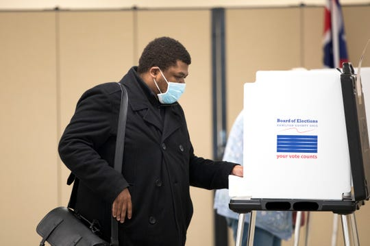 Cam Hardy votes at the Hamilton County Board of Elections on Tuesday, April 28, 2020, in Norwood.