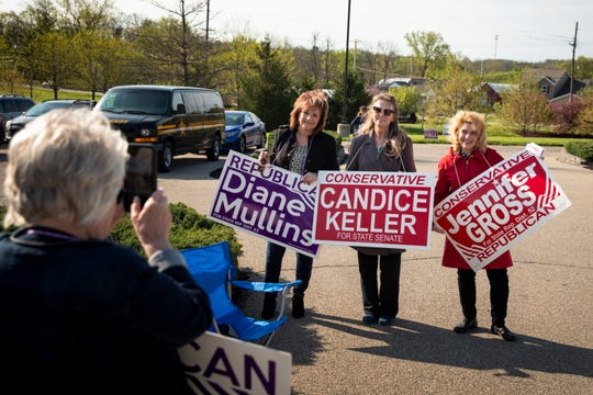 Sandy Sigmon takes a photo of candidates Diane Mullins, Candice Keller and Jennifer Gross outside the Butler County Board of Elections in Hamilton, Ohio on Tuesday, April 28, 2020.