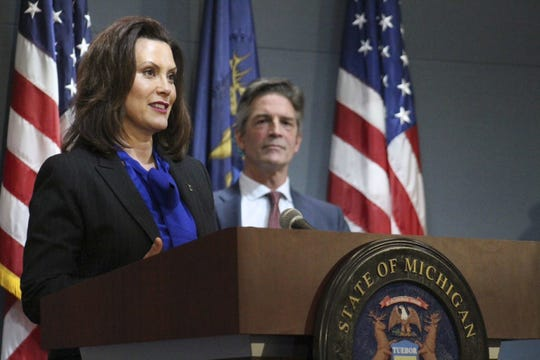 Gov. Gretchen Whitmer at coronavirus news conference as DTE Energy Executive Gerry Anderson looks on from Lansing Monday, April 27, 2020.