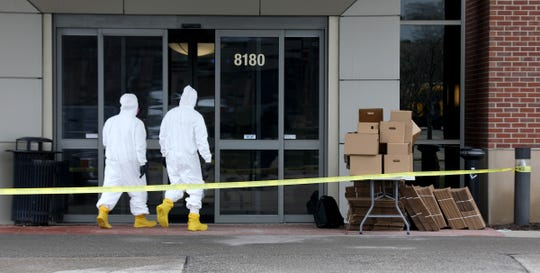 "Federal Bureau of Investigations evidence response team members head into the building where Allure Medical's office is in Shelby Township, Michigan on April 23, 2020. The Federal Bureau of Investigations raided Allure Medical for an alleged ""federal violation."""