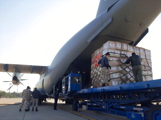In this photo provided by the Turkish Defense Ministry, Turkish soldiers load a military cargo plane with Personal Protection Equipment donated by Turkey to help United States combat the new coronavirus outbreak, at the Etimesgut airport outside Ankara, Turkey, Tuesday, April 28, 2020.