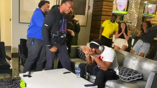 Romeo Okwara, who is wearing a black hoodie, celebrates after brother Julian Okwara, seated right, was selected by the Lions in the NFL Draft.