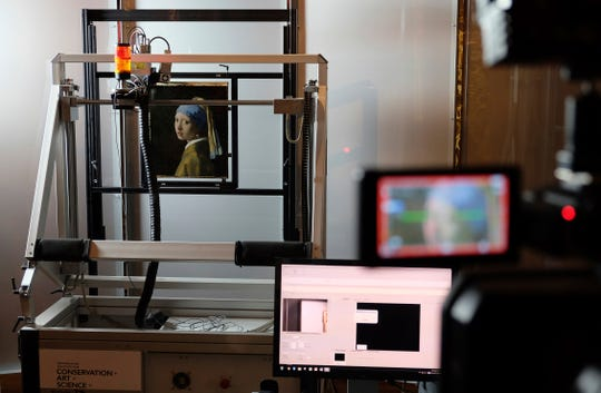 """A macro XRF scanner is used to study in minute detail the surface of Johannes Vermeer's 17th century masterpiece """"Girl with a Pearl Earring"""", at the Mauritshuis museum in The Hague, Netherlands on Feb. 26, 2018."""