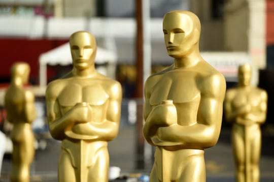 Oscar statues stand off of Hollywood Boulevard in preparation for the 92nd Academy Awards at the Dolby Theatre, Feb. 5, 2020, in Los Angeles.