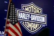 The logo for Harley-Davidson appears above a trading post on the floor of the New York Stock Exchange in this March 3, 2020, file photo. Harley-Davidson Inc. shares climbed after the new acting CEO laid out plans to cut costs and complexity and focus on its strengths.