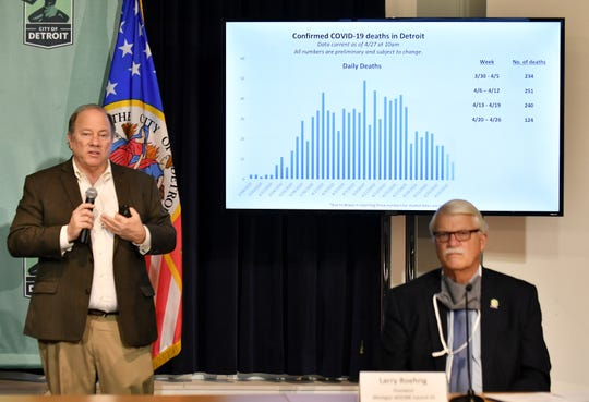 Mayor Mike Duggan, left, discusses a graphic Tuesday showing COVID-19 deaths in the city. Larry Roehrig, right, is president of Michigan AFSCME Council 25. The city is announcing the first services to reactivate under new COVID-19 workplace safety protocols.
