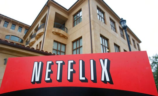 "This Jan. 29, 2010, file photo, shows the company logo and view of Netflix headquarters in Los Gatos, Calif. COVID-19 may have knocked U.S. stocks into a bear market and pummeled the U.S. economy, but the disease has also left some companies asking the question: ""What recession?"""