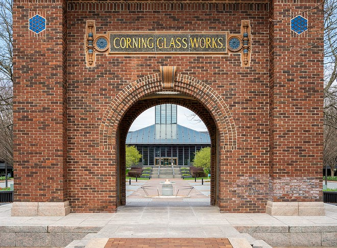 The entrance to Corning Inc. Global Headquarters in Corning is seen Tuesday through the historic arch that bears the company's former name.