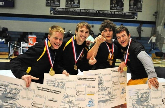 Dan Manganaro, third from left, and Ursinus College teammates take a photo with their medals after the 2013 Centennial Conference Wrestling Championships.