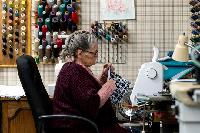 Don's Claytons seamstress Nancy Wright sews face masks in her workroom at their W Morgan Avenue location Monday morning, April 27, 2020. The local dry-cleaning chain is offering free masks for the community amid the COVID-19 pandemic.