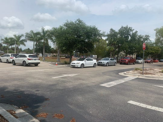 About 200 cars and trucks visited Sysco's drive-through grocery store last week at Southwest Florida Event Center, organizers said.
