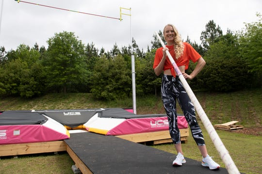 Pole vaulter Sandi Morris stands outside on the runway built near her parents' home Saturday, April 25, 2020.