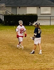 Wade Hampton lacrosse's Evan Bolling (25) has had to deal with his senior season being cut short by the spread of COVID-19.