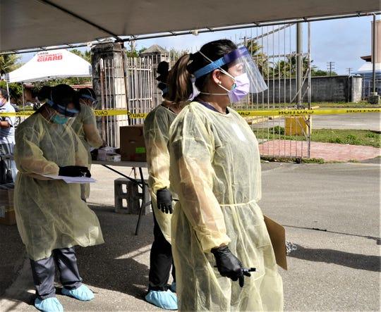 Zenia Pecina, a Guam DPHSS nurse kept a sharp eye on the screening for COVINA-19 testing at Astumbo Dededo Elementary School, Tuesday afternoon, April 28, 2020 at Dededo, Guam.