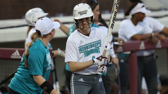 """Former Mississippi State softball player Alex Wilcox inspired her teammates and coaches to do a """"wall sit challenge"""" in her honor. Wilcox died of ovarian cancer in June 2018."""