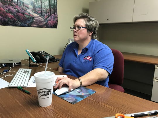 Denise Strub puts together the final edition of The Bolivar Commercial on Monday, April 27, 2020. The newspaper in the Mississippi Delta closed after more than a century in business.