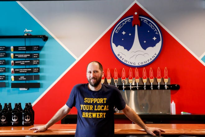 Jason Behenna, owner of Escape Velocity Brewing Company, stands inside the recently opened Sagamore Parkway brewery, Tuesday, April 28, 2020 in Lafayette.