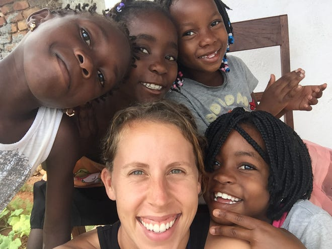 Stacie Scott, a Louisville native, with some neighbor girls while on assignment in Mozambique. Scott was sent back to the U.S. along with more than 7,000 Peace Corps volunteers as COVID-19 spread worldwide.