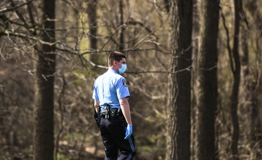 Lansing Police search an area near Tecumseh River Road while doing a welfare check on a missing 43-year-old woman.