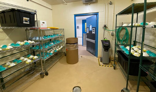 Michigan State University Animal Care Program officials adopted a process where masks and other personal protective equipment used in the COVID-19 fight can be decontaminated in a room, like the one shown, using a hydrogen peroxide fog.