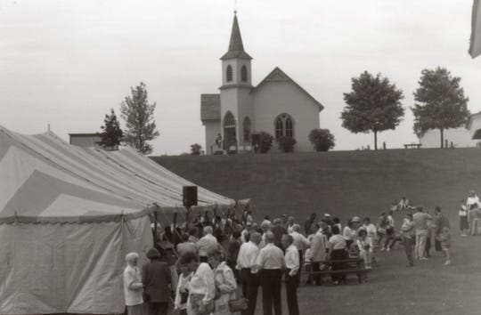 Learn the behind-the-scenes story of how Pinecrest Historical Village began 50 years ago during a Creating Pincrest webinar on May 14. Pictured is a Concert on the Village Green from 1991 with the Niles Community Church in the background.