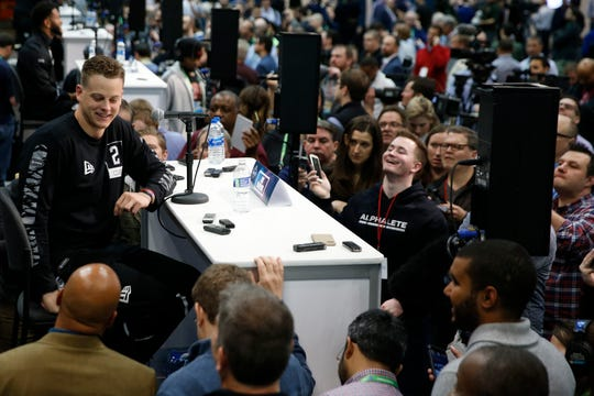 Former Ohio State quarterback Joe Burrow, who won the Heisman Trophy for LSU this past season, speaks to the media during the NFL Combine at the Indiana Convention Center in February.