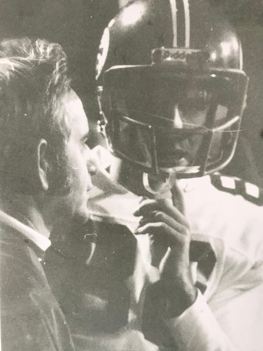 Jerry Widder and his son, Terry, talk strategy during a game at Clear Fork in the late '70s. Widder passed away on April 24 leaving behind a legendary coaching career.
