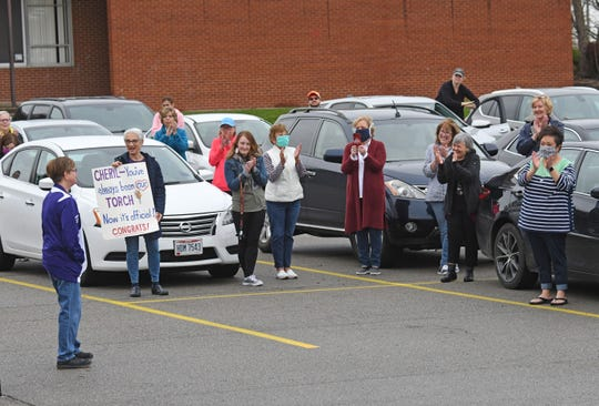 Lexington school staffers applaud Cheryl Longnecker after she was named a TORCH Award winner on Tuesday morning.