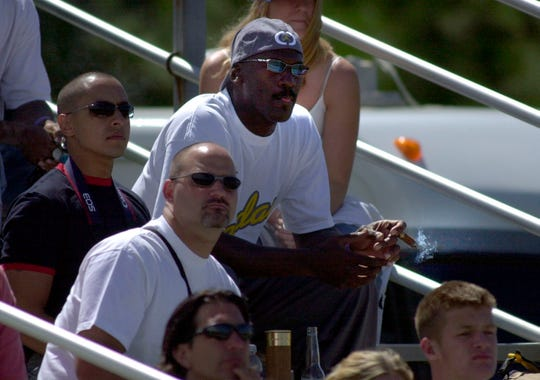 Basketball star and budding motorsports team owner Michael Jordan watches the Formula Xtreme race Saturday, July 24, 2004, at the Mid-Ohio Sports Car Course in Lexington, Ohio, during the Honda Super Cycle Weekend. This was the first year of Michael Jordan Motorsports competing in American motorcycle road racing.