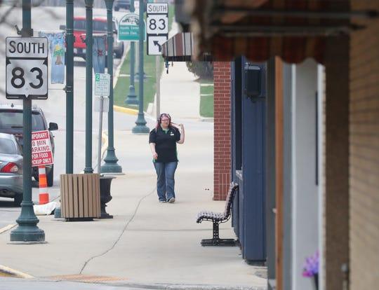 A pedestrian walks along Main Street in Hartford on Tuesday.