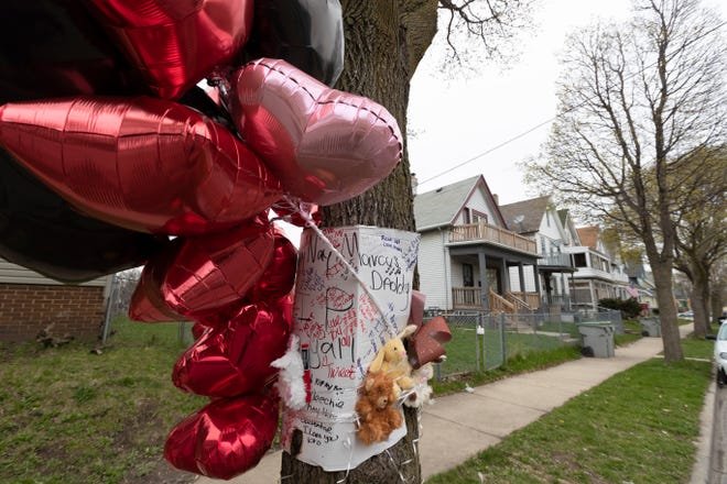 A memorial to five people who were shot to death April 27 is tied to a tree in the 2800 block of North 12th Street. Christopher P. Stokes, the suspected gunman, repeatedly came to the attention of authorities for allegations of violence, according to online court and state records.
