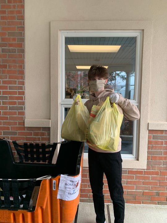 Chatham High School sophomore Matthew Gallop delivers food donations to the Interfaith Food Pantry and Resource Center in Morris Plains.