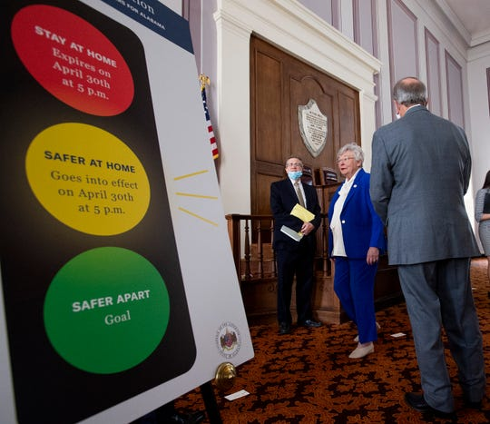 State Health Officer Dr. Scott Harris and Governor Kay Ivey after her announcement of continued social distancing during her coronavirus update at the state capitol building in Montgomery, Ala., on Tuesday April 28, 2020.