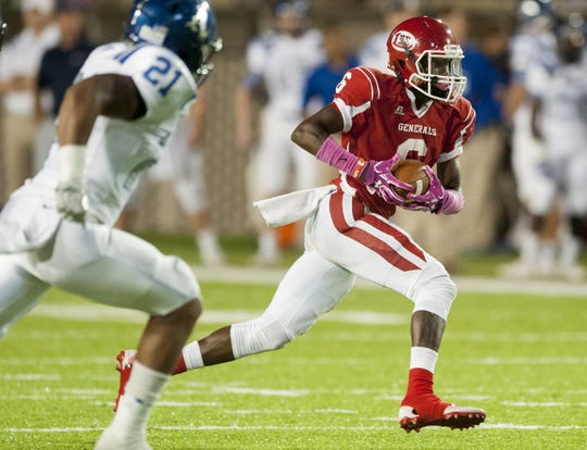 Lee's Henry Ruggs (6) carries against Auburn in first half action at Cramton Bowl in Montgomery, Ala. on Thursday October 6, 2016.