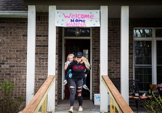 The Kittrell family decorate their home during a drive thru homecoming party for Hanna, 16, who suffered serious injuries in a car accident last December.