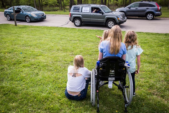 Hanna Geelhoed, 16, received a drive thru homecoming celebration Friday, April 24, 2020, attended by friends, family and neighbors after returning to her home in Yorktown following a long stay in the hospital where she was being treated for injuries suffered in a serious car accident that occurred last December.