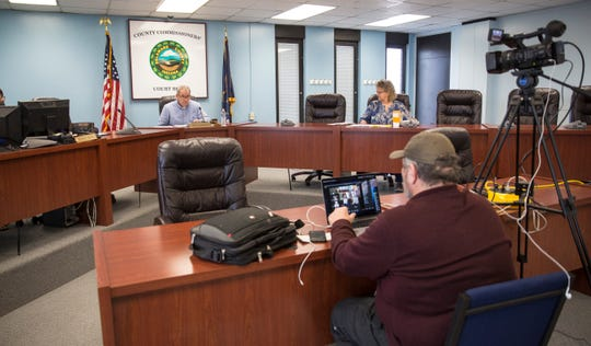 Scott Alexander, Delaware County Council President, holds a teleconference meeting with the other members of council from the county building on April 28.