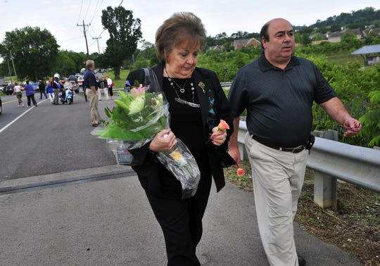 Mary Margaret Lambert and her brother Joe Formosa walk to the bridge to throw a flower into the Harpeth for their father, Joseph Formosa, who died in the May 2010 flood. The family had just attended the dedication of the Formosa McCormac Memorial Bridge, dedicated to flood victims Joseph and Bessie Formosa and Mary Jane McCormac on Old Harding Pike in Bellevue on May 19, 2011.