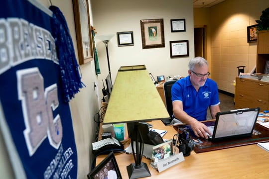 Principal Jon Bremseth works on his laptop at Barron Collier High School in Naples on Thursday, April 23, 2020.