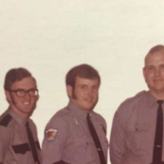 Retired Heath police Sgt. Jack Jones (center) appears in a posed photo from 1977.