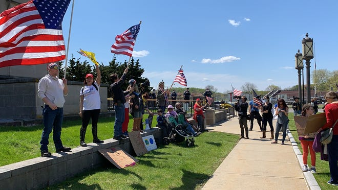 Protesters gathered outside the Trenton War Memorial Tuesday, April 28, 2020, where Gov. Phil Murphy delivered his daily coronavirus briefing.
