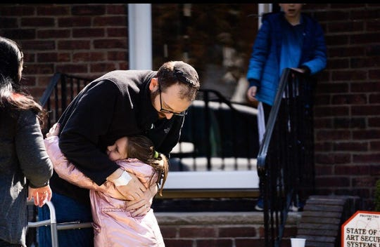 Michael Goldsmith hugging his daughter after being released from the hospital on April 18.
