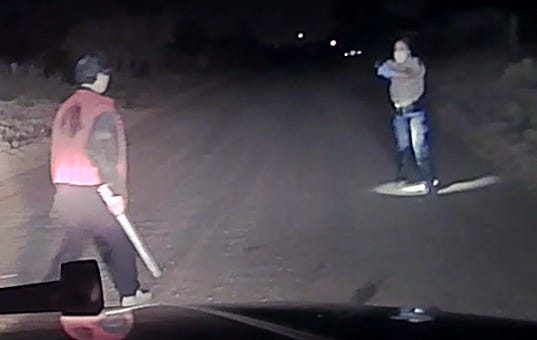 The Doña Ana County Sheriff's Office released a still image from dash cam video taken Monday, April 27, 2020. The deputy purportedly shot the man with the baseball bat, who remained in critical condition Tuesday.