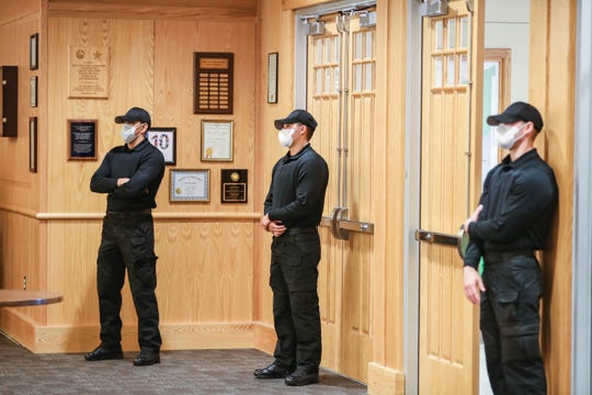 Security wear masks at the Doña Ana County Commission Chambers in Las Cruces on Tuesday, April 28, 2020.