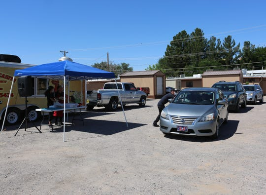 Just before noon, a line formed behind La Nueva Casita Café, at 195 N. Mesquite St. in Las Cruces, as residents wait for free enchilada plates.