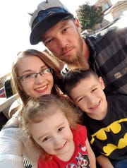 Justyn Miller, 33, of La Luz, pictured here with his family, was killed in a motorcycle crash April 26, 2020.