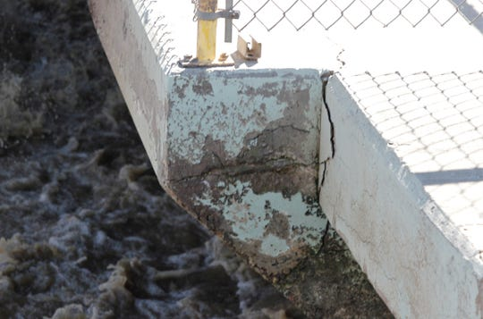 Cracks are seen in the concrete at the wastewater treatment facility in February in Bloomfield.