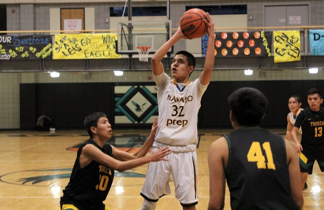 Navajo Prep's Lance Morris, seen here playing against Thoreau on Wednesday, Jan. 29, 2020, at the Eagles Nest in Farmington, will continue his basketball career at NAIA's Arizona Christian University.