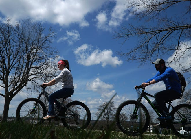 Bicyclists hit the trail at Kensington Metropark on April 28, 2020. Drive-in movies are coming to Kensington this pandemic summer, with guests invited to socially distance in vehicles or on bikes.